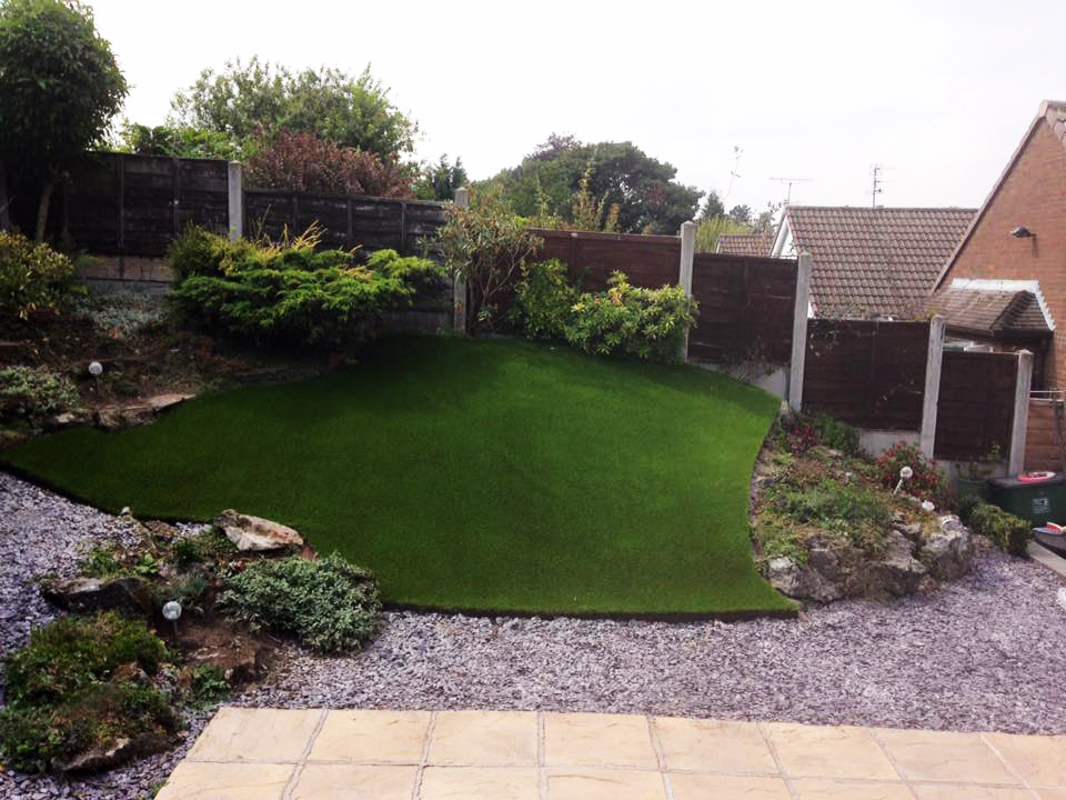 Awkward sloped gardens can be saved by using artificial grass for Garden decking with artificial grass