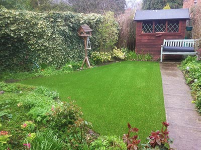 Artificial grass has made all the difference to this charming garden