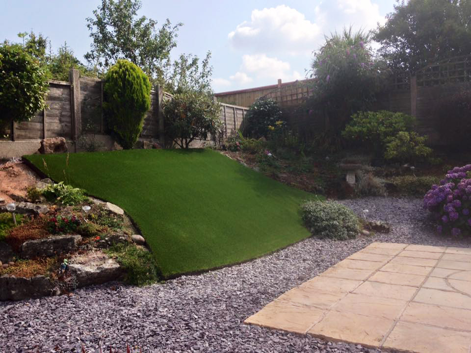 Awkward sloped gardens can be saved by using artificial grass!